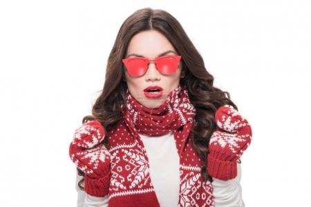 Woman in scarf and mittens wearing sunglasses