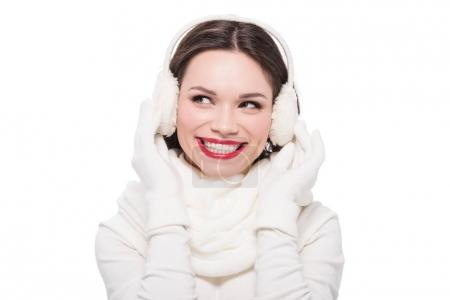 Woman with red lips in earmuffs