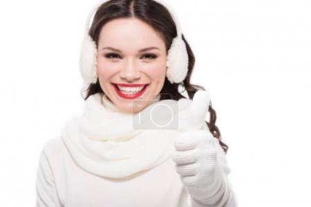 Woman in earmuffs showing thumb up