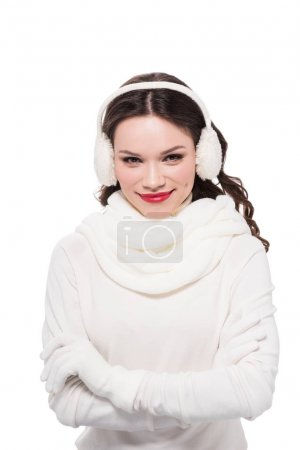 Smiling woman in earmuffs and scarf