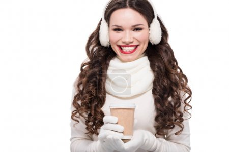 woman in winter attire holding cup
