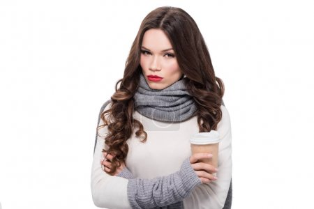 woman in arm warmers holding cup