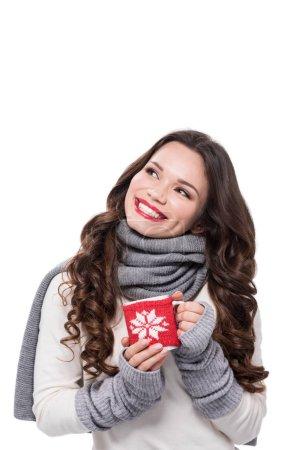 Smiling woman holding coffee mug