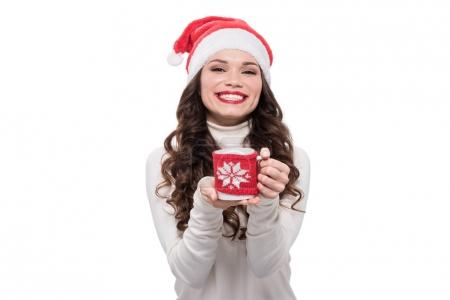 Woman in santa hat wtih coffee cup