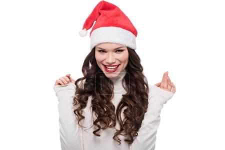 Smiling woman in santa hat