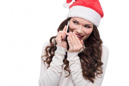 woman in santa hat talking on phone