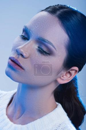 Young woman with frost on face
