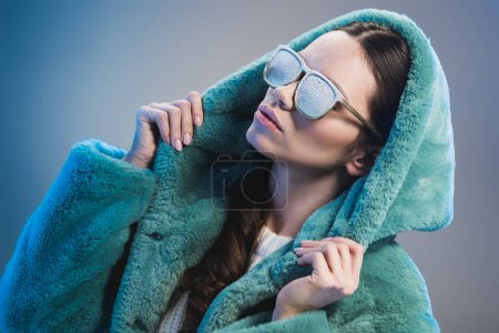 Trendy woman covered in frost