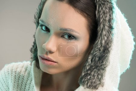 Woman in sweater with frost on face