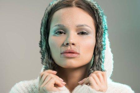 Beautiful woman in hooded sweater