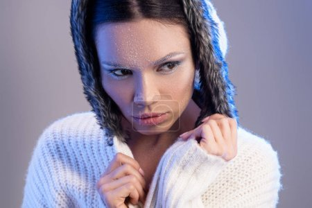 woman with frost on face in sweater