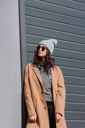 Photo for Stylish woman in autumn outfit and black sunglasses standing outside - Royalty Free Image