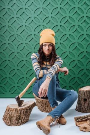 Woman sitting on wooden stupms