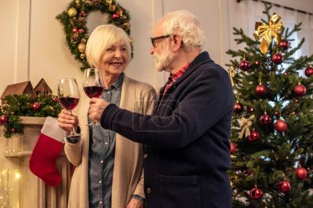 couple clinking with wine glasses