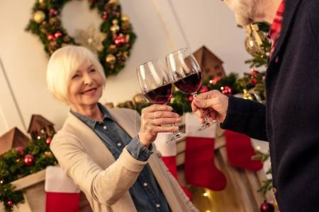 senior with wine at christmas eve