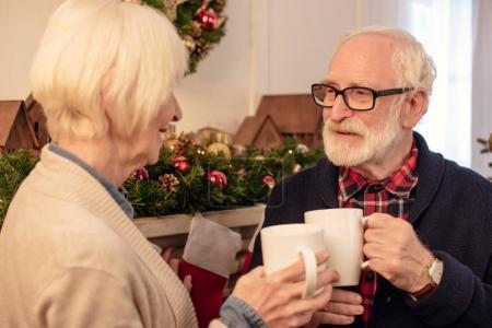senior couple with coffee at christmas