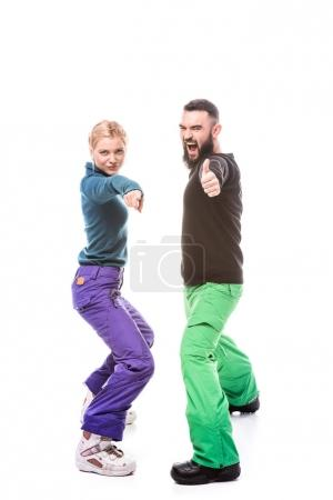 Photo for Emotional young couple in snowboarding clothes gesturing isolated on white - Royalty Free Image