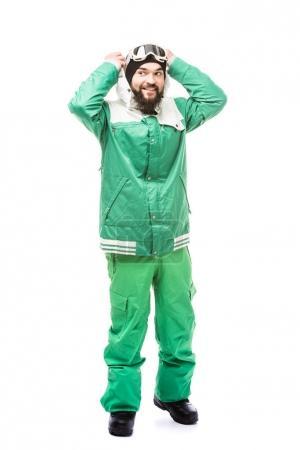 Photo pour Homme souriant en costume de snowboard regardant loin isolé sur blanc - image libre de droit