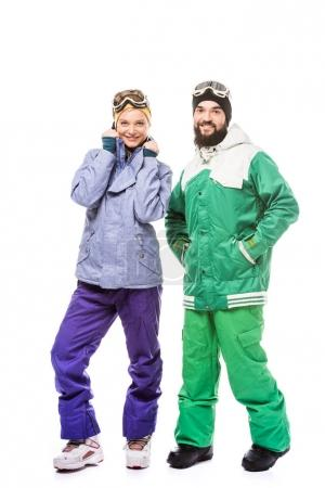 happy couple in snowboarding costumes
