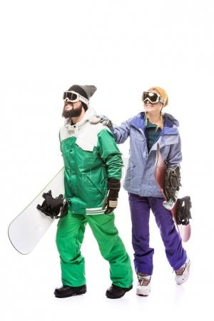 Couple in snowboarding costumes with snowboards