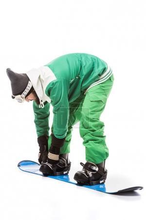 man tying snowboard equipment