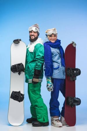 happy couple wit snowboards