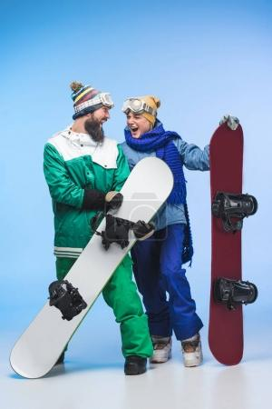 young snowboarders with snowboards