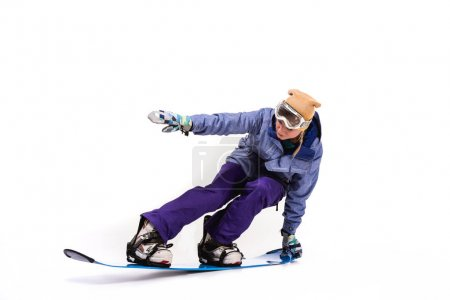 woman sliding on snowboard