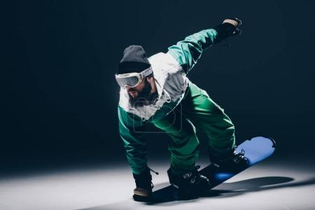 snowboarder practicing on snowboard