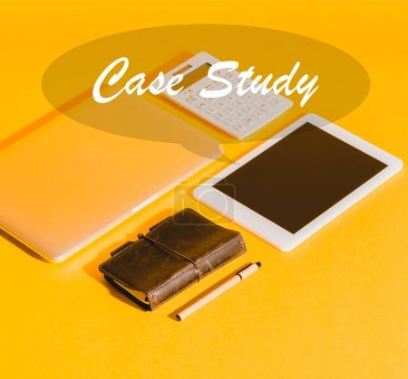 Photo for Close-up view of digital devices, calculator and notebook with inscription case study - Royalty Free Image