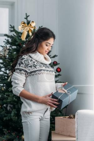 woman with handmade decorated christmas gift