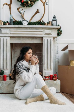woman with hot drink on christmas