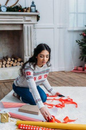 woman packing christmas gift