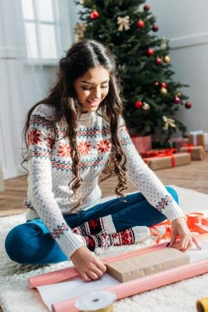 woman packing christmas gift