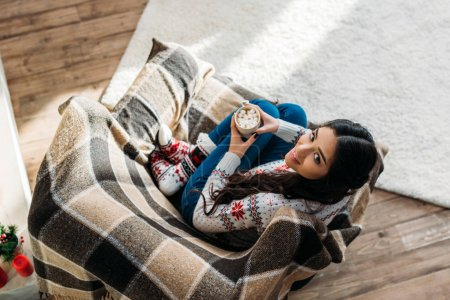 woman enjoying hot chocolate with marshmallow