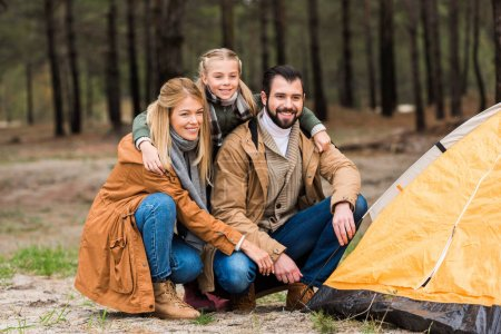 young family installing tent