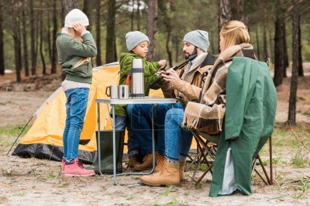 Photo for Beautiful young family on camping in forest - Royalty Free Image