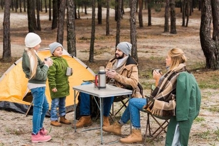 family on camping in forest