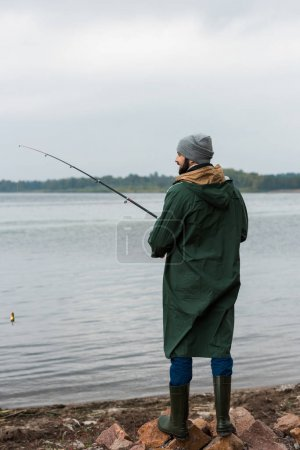 man fishing on lake