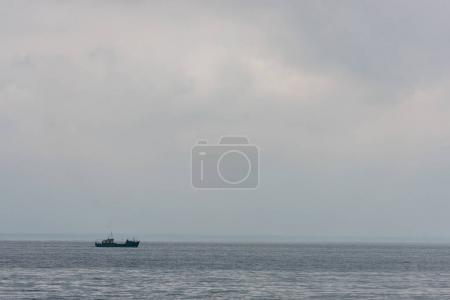 Lonely ship floating in sea