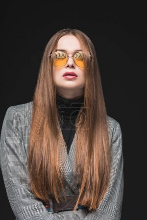 woman in gray jacket and yellow sunglasses