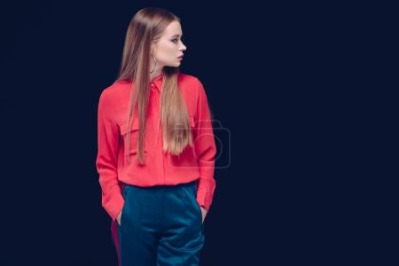 Photo for Beautiful woman in red shirt standing isolated on black - Royalty Free Image