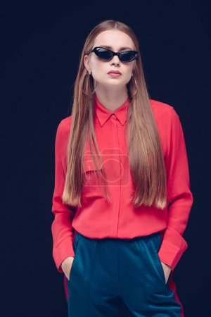 woman in red shirt and black sunglasses