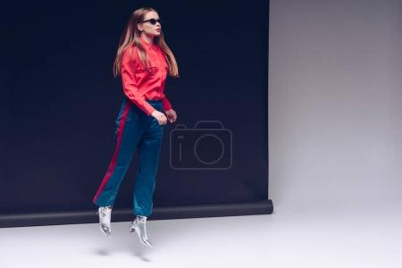 girl jumping in red shirt