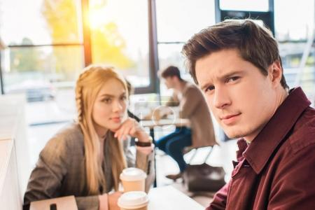 Man sitting with girl in cafe
