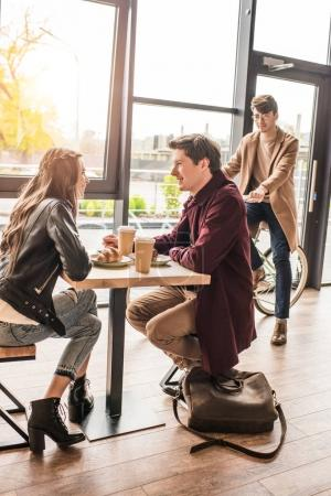 Couple sitting at table in cafe