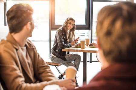 men looking at girl at adjacent table