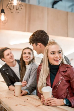 friends standing with coffee