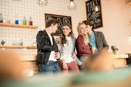 friends standing at bar counter