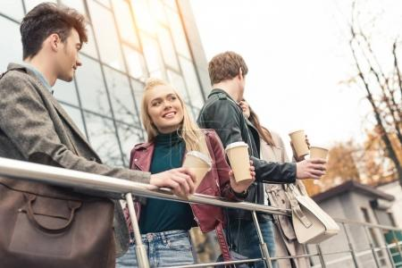 Two couples with disposable coffee cups